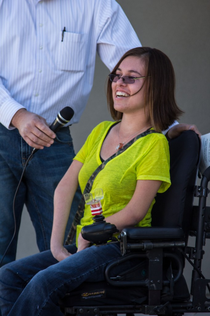 Lindsey Smith, more tears than words, at ribbon-cutting ceremony for her new home