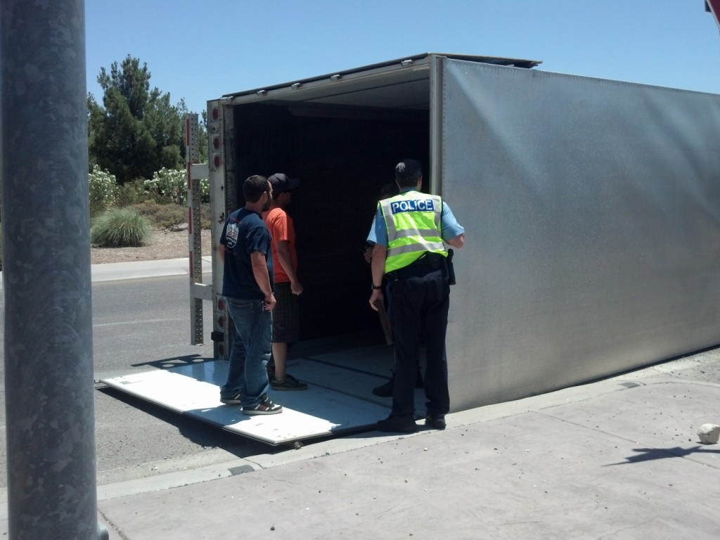 Crew from Brackens Auto Tech at overturned Moss semitrailer
