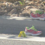Jogging shoes are placed on the road and curb as part of a reconstruction of the incident on Red Hills Parkway, St. George, Utah, July 25, 2014 | Photo by Mori Kessler, St. George News