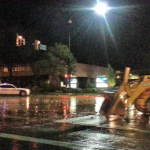 Police were stopping traffic on St. George Boulevard  and 200 East as well at 100 South and 1000 East so Backhoe crews could scrape away large rocks that had run off of the hill and into the streets. St. George, Utah, Aug. 26, 2014 | Photo by Brett Barrett, St. George News