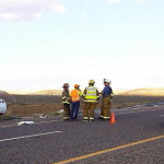 St. George firefighters stand on scene near a Corvette that crashed on state Route 7 just west of the River Road on-ramp, St. George, Utah, Oct. 25, 2014   Photo by Aspen Stoddard, St. George News