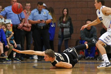 Thunder F Quincy Mathews (22) dives for a loose ball. File photo from Desert Hills vs.Dixie, Boys Basketball, St. George, Utah, Dec. 17, 2014 | Photo by Robert Hoppie, ASPpix.com, St. George News