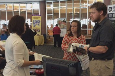Alicia Robertson, Amangiri Luxury Resort human resource manager, shares job opportunities with Army veteran Travis Carlson at the Hero to Hired Job Fair, St. George, Utah, Jan. 22, 2015 | Photo by Holly Coombs, St. George News