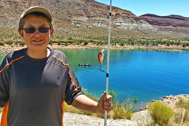 Young boy fishing at Quail Creek Reservoir| Photo Brett Barrett, St. George News