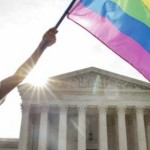 Carlos McKnight of Washington, waves a flag in support of gay marriage outside of the Supreme Court in Washington,  June 26, 2015. A major opinion on gay marriage is among the remaining to be released before the term ends at the end of June. | Photo courtesy of AP Photo/Jacquelyn Martin. St. George News