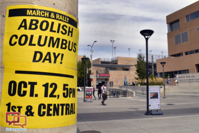 A flyer on the campus of the University of New Mexico in Albuquerque calls for students to join a protest against Columbus Day. Monday, Oct. 12, 2015, marks the annual Columbus Day nationwide, but in a twist that signals a growing trend, it will also be Indigenous Peoples Day in at least nine U.S. cities this year, Albuquerque, New Mexico, Sept. 21, 2015 | AP Photo by Russell Contreras, St. George News