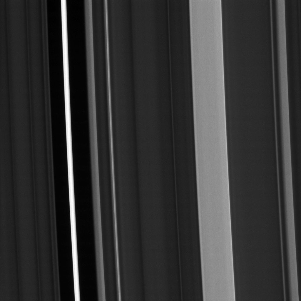 Of planet earth as a point of light between the icy rings of saturn - Saturn S C Ring Isn T Uniformly Bright As Seen From The Spacecraft Cassini Instead About A Dozen Regions Of The Ring Stand Out As Noticeably Brighter