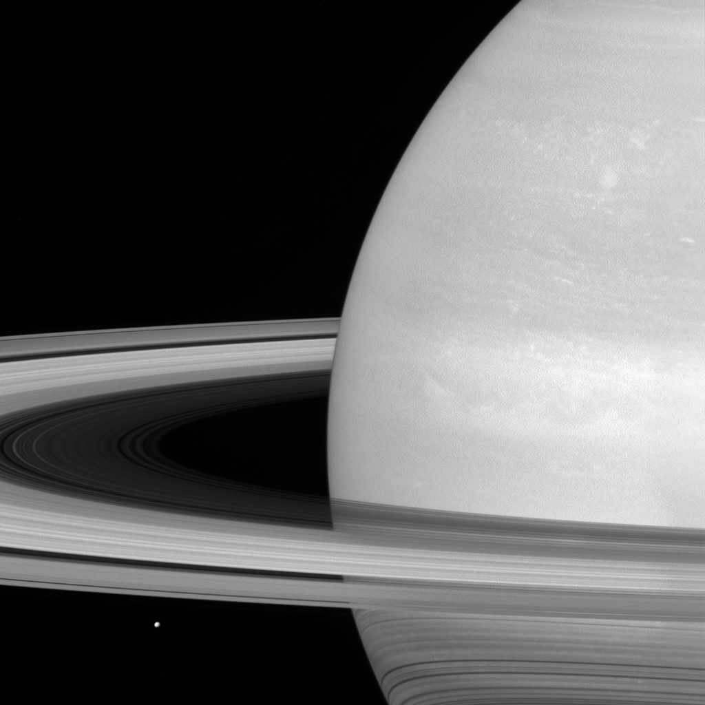Of planet earth as a point of light between the icy rings of saturn - For Scale Saturn S Moon Mimas Seen Elsewhere In This Photo Gallery Is Located Lower Left Just Below The Rings In This Cassini View