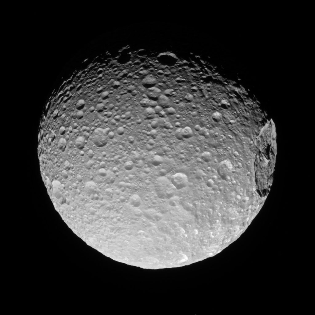 Of planet earth as a point of light between the icy rings of saturn - 1 Of Saturn S 62 Moons Mimas Gigantic Crater Herschel Lies Near The Moon S Limb In This Cassini View November 19 2016 Photo Courtesy Of